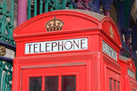 London telephone - red phone booth typical for England. Stock Photo