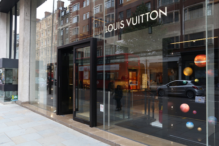 knightsbridge: LONDON, UK - JULY 9, 2016: Louis Vuitton fashion store at Sloane Street in London. Sloane Street is located in Royal Borough of Kensington and Chelsea and is known for its luxury brand stores.