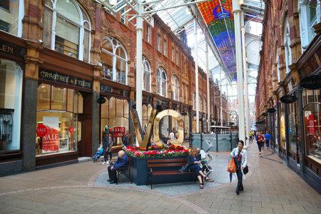 LEEDS, UK - JULY 11, 2016: People visit shops of Victoria Quarter in Leeds, UK. The arcaded streets of Victoria Quarter near Briggate street have many upmarket brand shops.