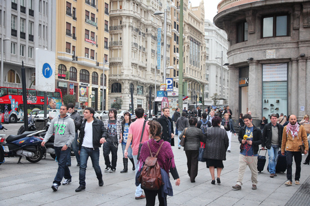 european: MADRID, SPAIN - OCTOBER 24, 2012: People shop downtown in Madrid. Madrid is a popular tourism destinations with 3.9 million estimated annual visitors (official data).
