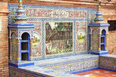 Huesca theme - traditional Spanish tile ornament at a public square Plaza de Espana in Seville, Spain.