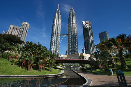 KUALA LUMPUR, MALAYSIA - MARCH 29, 2009: Petronas Towers skyscraper in Kuala Lumpur, Malaysia. Petronas is the 7th tallest building in the world as of 2013.