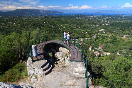 CORFU, GREECE - JUNE 3, 2016: People visit Kaisers Throne overlook viewpoint, Corfu Island, Greece. 558,000 tourists visited Corfu in 2012.