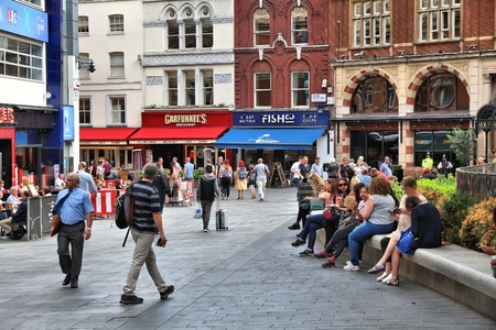 LONDON, UK - JULY 6, 2016: People visit Leicester Square in London, UK. London is the most populous city in the UK with 13 million people living in its metro area.