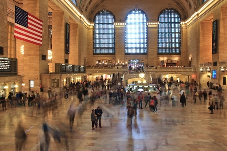NEW YORK, USA - JUNE 7, 2013: People hurry in Grand Central Terminal in New York. The station exists since 1871. It had passenger ridership of 82 million in 2011.