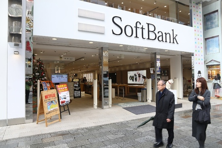 TOKYO, JAPAN - DECEMBER 1, 2016: People walk by SoftBank mobile phone network store in Tokyo, Japan. There are 146.6 million mobile phones in use in Japan (2013).