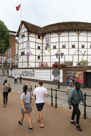 globe theatre: LONDON, UK - JULY 8, 2016: People visit The Globe theatre in London, UK. London is the most populous city in the UK with 13 million people living in its metro area.