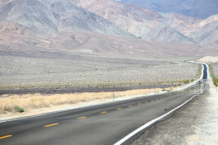 Death Valley road - highway route in Mojave Desert, California.