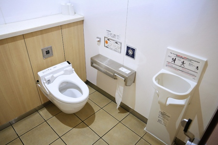 TOKYO, JAPAN - DECEMBER 2, 2016: Modern high tech toilet with electronic bidet in Japan. Industry leaders recently agreed on signage standards for Japanese toilet bowls.