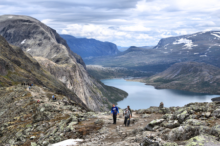 JOTUNHEIMEN, NORWAY - AUGUST 1, 2015: People hike the Besseggen trail in Jotunheimen National Park, Norway. Norway had almost 5 million foreign visitors in 2011.