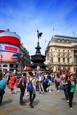 million: LONDON, UK - JULY 7, 2016: People visit Piccadilly Circus in London. London is the most populous city in the UK with 13 million people living in its metro area. Editorial