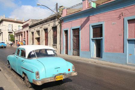 capita: MATANZAS, CUBA - FEBRUARY 23, 2011: Old American car in Matanzas, Cuba. Cuba has one of the lowest car-per-capita rates (38 per 1000 people in 2008).