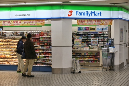 NARA, JAPAN - NOVEMBER 23, 2016: People visit FamilyMart convenience store in Tokyo, Japan. FamilyMart is one of largest convenience store franchise chains in Japan with 7,604 shops (2012). Editorial