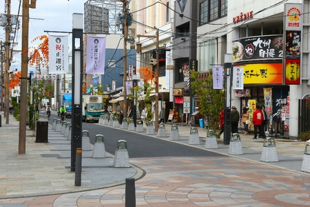 inhabited: NARA, JAPAN - NOVEMBER 23, 2016: People visit a shopping area in Nara, Japan. Nara is a former capital city of Japan. Nowadays its a big city inhabited by 368,636 people.