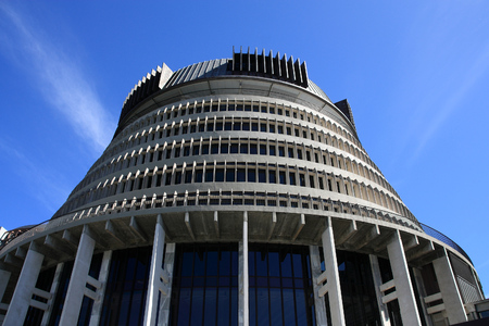 WELLINGTON, NEW ZEALAND - MARCH 7, 2008: Exterior view of New Zealand Parliament building in Wellington. The structure is informally known as the Beehive.