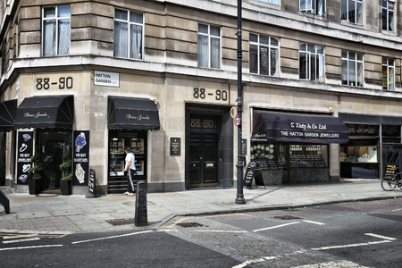 was: LONDON, UK - JULY 9, 2016: People shop at Hatton Garden in Holborn district of London. Hatton Garden Safe Deposit Company was involved in the 2015 heist.