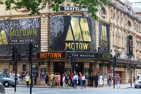 shaftesbury: LONDON, UK - JULY 9, 2016: People walk by Shaftesbury Theatre in West End, London, UK. West End theatres sold 14.4 million tickets in 2013.