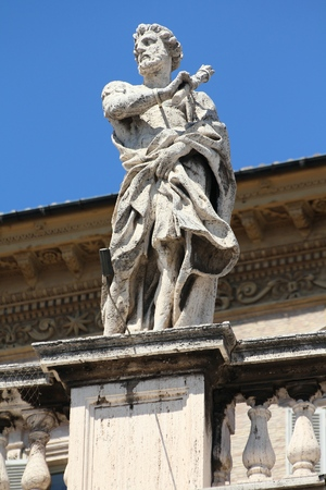 colonnade: Vatican - Saint Didymus, sculpture in the colonnade of famous Saint Peters Square. Stock Photo
