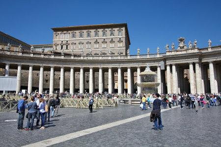 most popular: VATICAN CITY, VATICAN - APRIL 9, 2012: People visit Saint Peters Square in Vatican City, Vatican. Saint Peters Square is among most popular pilgrimage sites for Roman Catholics.
