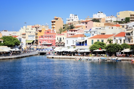 AGIOS NIKOLAOS, GREECE - MAY 15, 2013: People visit Old Town in Agios Nikolaos. According to Tripadvisor it is the 5th most popular destination in Greek island of Crete.