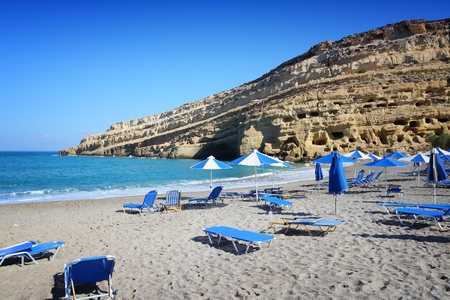 Matala, Crete - beach view with hippie caves in background.