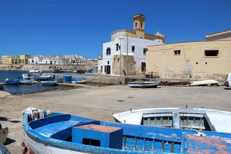 Gallipoli, town in Apulia, Italy. Boats in harbor.
