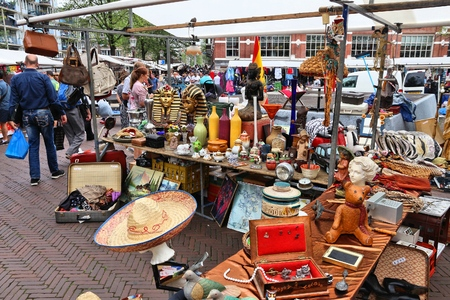 AMSTERDAM, NETHERLANDS - JULY 8, 2017: People visit Waterlooplein Market in Amsterdam, Netherlands. The popular flea market has up to 300 stalls.