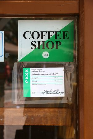 AMSTERDAM, NETHERLANDS - JULY 8, 2017: Legal permit in a window of a coffee shop in Amsterdam, Netherlands. Coffeeshops legally sell marijuana for personal consumption.