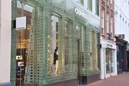 upscale: AMSTERDAM, NETHERLANDS - JULY 10, 2017: Chanel fashion shop at P.C. Hooftstraat in Amsterdam. Pieter Cornelis Hooftstraat is the ultimate upscale shopping street in the Netherlands.