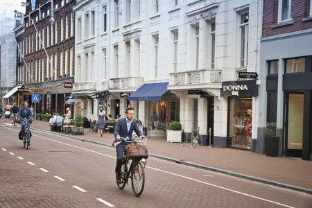 upscale: AMSTERDAM, NETHERLANDS - JULY 10, 2017: People visit P.C. Hooftstraat in Amsterdam. Pieter Cornelis Hooftstraat is the ultimate upscale shopping street in the Netherlands. Editorial