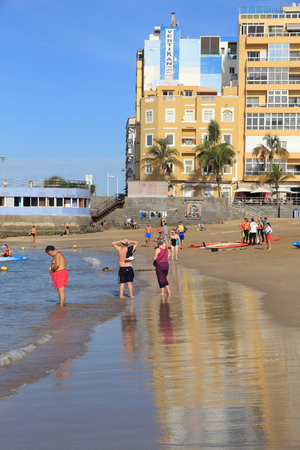 LAS PALMAS, SPAIN - NOVEMBER 30, 2015: People visit Las Canteras Beach in Las Palmas, Gran Canaria, Spain. Canary Islands had record 12.9 million visitors in 2014. Editorial