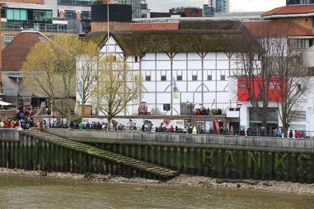 globe theatre: LONDON, UK - APRIL 23, 2016: People visit The Globe theatre in London, UK. London is the most populous city in the UK with 13 million people living in its metro area.