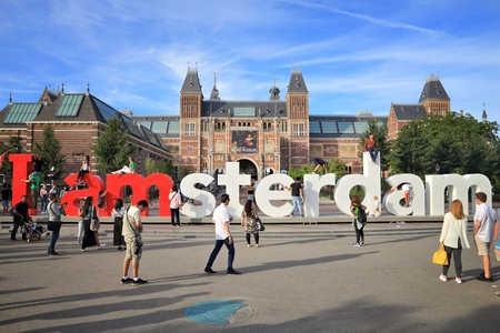 AMSTERDAM, NETHERLANDS - JULY 9, 2017: People visit Rijks Museum in Amsterdam. Amsterdam is the capital city of Netherlands, with population of 1,351,587 in its urban area. Editöryel
