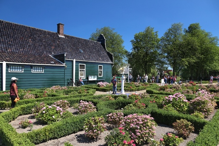 ZAANSE SCHANS, NETHERLANDS - JULY 9, 2017: People visit Zaanse Schans restored village in the Netherlands. The popular tourist attraction had 1.6 million visitors in 2014. Editorial