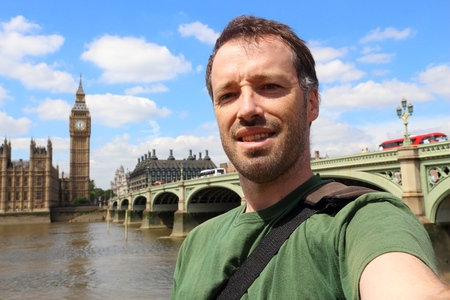 Tourist selfie with London parliament and Big Ben.