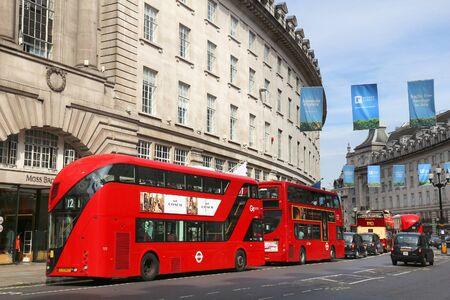 regent: LONDON, UK - JULY 7, 2016: People shop at Regent Street in London. Regent Street is a major shopping street in West End of London. Editorial