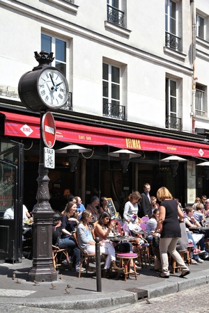 PARIS, FRANCE - JULY 24, 2011: People visit Cafe Delmas in Paris, France. Paris is the most visited city in the world with 15.6 million international arrivals in 2011. Editöryel