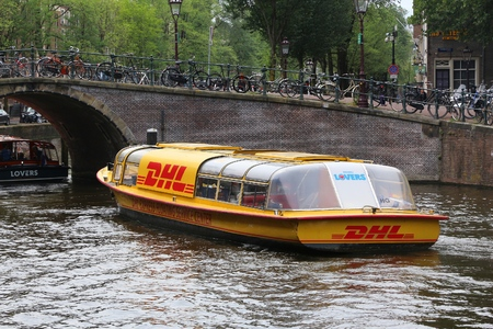 AMSTERDAM, NETHERLANDS - JULY 10, 2017: DHL Express floating Service Center in Amsterdam, Netherlands. DHL is a world market leader in sea and air mail. It exists since 1969. Editorial