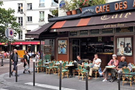 PARIS, FRANCE - JULY 24, 2011: People visit Cafe des Arts in Paris, France. Paris is the most visited city in the world with 15.6 million international arrivals in 2011.