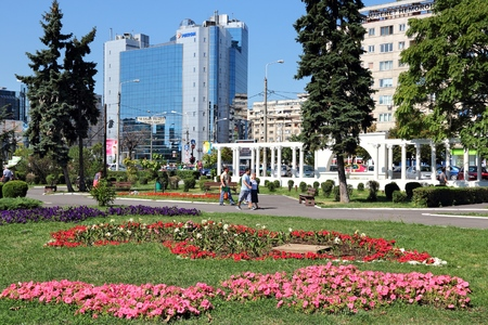 PLOIESTI, ROMANIA - AUGUST 20, 2012: People visit city park in Ploiesti, Romania. Ploiesti is the 9th largest city in Romania and exists since 1596. It is famous for oil industry.