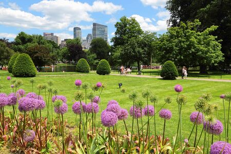 BOSTON, USA - JUNE 9, 2013: People visit Public Garden in Boston. Public Garden dates back to 1837 and is a registered monument.