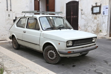 APULIA, ITALY - JUNE 6, 2017: Fiat 127 youngtimer hatchback car parked in Italy. There are 41 million motor vehicles registered in Italy.