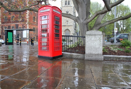 old english: London, UK - red telephone box in the rain. Stock Photo