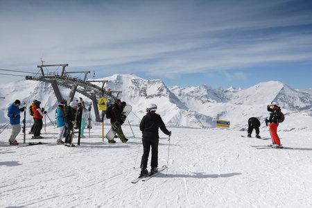 GASTEIN VALLEY, AUSTRIA - MARCH 10, 2016: People visit Sportgastein ski resort in Austria. It is part of Ski Amade, one of largest ski regions in Europe with 760km of ski runs. Editorial