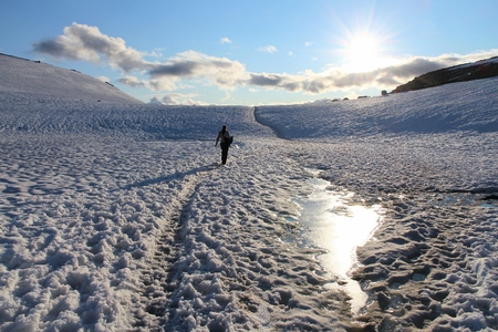 Wanderlust concept - hiking adventure in Hordaland, Norway. Snow trail to Trolltunga rock.