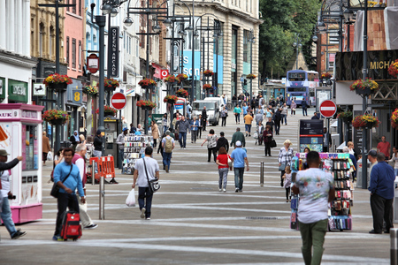 old english: LEEDS, UK - JULY 12, 2016: People shop at Briggate street in downtown Leeds, UK. Leeds urban area has 1.78 million population. Editorial