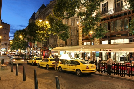 BUDAPEST, HUNGARY - JUNE 21, 2014: Taxi drivers wait for customers in the evening in Budapest. 3.3 million people live in Budapest Metropolitan Area. It is the largest city in Hungary and 9th largest in the EU. Editorial
