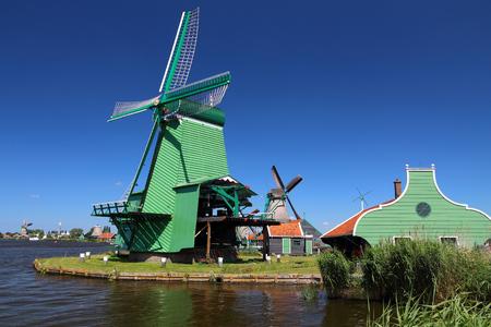 zaandam: Windmills in Netherlands. Old industrial architecture in Zaanse Schans rural area in Zaandam.