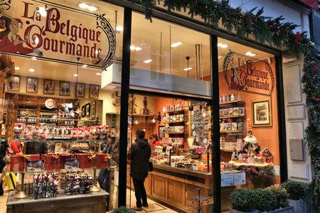 BRUSSELS, BELGIUM - NOVEMBER 19, 2016: People walk by Belgian chocolate store La Belgique Gourmande in Brussels. There are over 2,000 chocolatiers in Belgium.