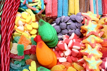 Confectionery shop at Boqueria market in Barcelona, Spain. Colorful gumdrops and wine gum sweets. Stock Photo